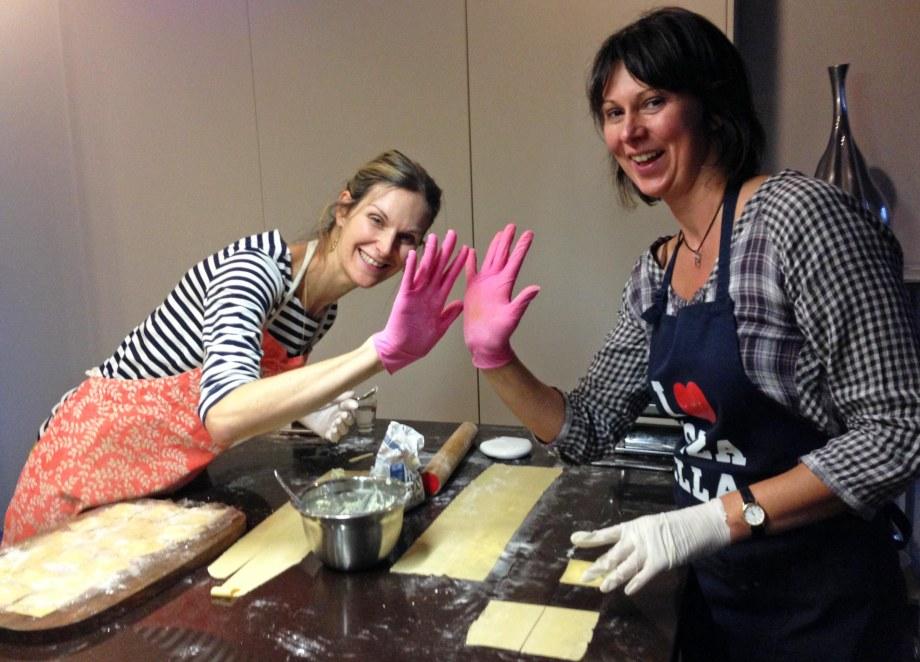 making ravioli wearing pink gloves