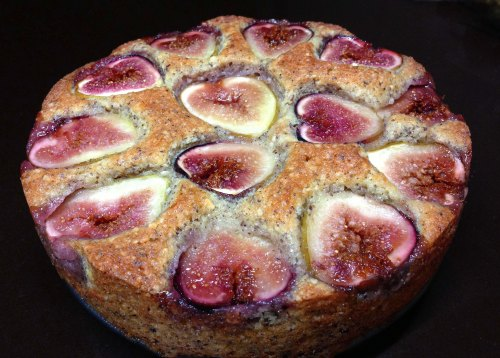 whole fig cake on black background
