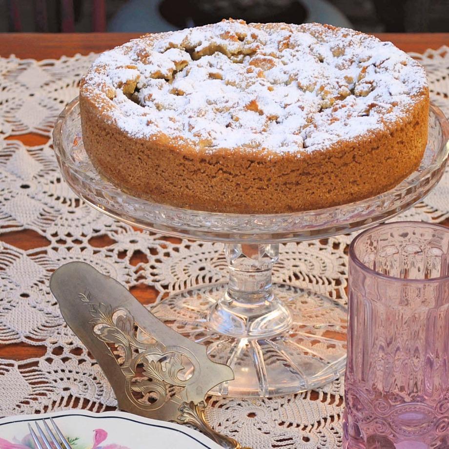italian apple cake on cake server